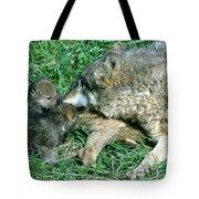 Mother Wolf Nuzzles Cubs Tote Bag
