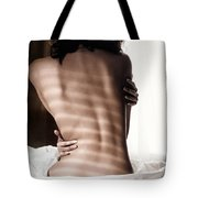 Naked Back Of A Woman Sitting On A Bed In Dramatic Light Tote Bag
