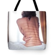 Naked Back Of A Woman Sitting On A Bed Tote Bag