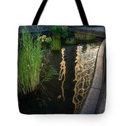 New York Skyscrapers Reflecting In A Beautiful Little Fountain With Flowers Tote Bag