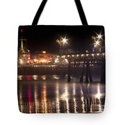 Night On Santa Monica Beach Pier With Bright Colorful Lights Reflecting On The Ocean And Sand Fine A Tote Bag