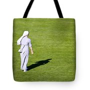 Nun On Green Soccer Field Tote Bag by Brch Photography