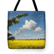 Oilseed Rape Field Against Blue Sky Tote Bag