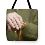 Old Hands Of A Senior On Walking Stick Tote Bag