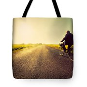 Old Man Riding A Bike To Sunny Sunset Sky Tote Bag