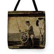 old sailor A vintage processed photo of a sailor sitted behind the rudder in Mediterranean sailing Tote Bag