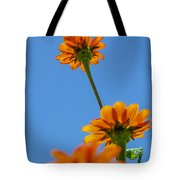 Orange Flowers On Blue Sky Tote Bag