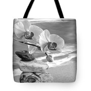 Orchids And Pebbles On The Sand In Black And White Tote Bag