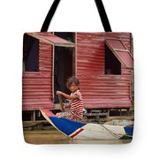 Paddling Through The Village Tote Bag