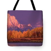 Panorama Dawn Lights Up Mount Moran In Grand Tetons National Park Tote Bag