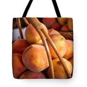 Peaches In Wicker Basket Tote Bag