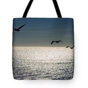 Pelicans In Flight Tote Bag