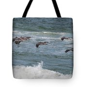 Pelicans Over The Water Tote Bag