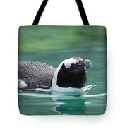 Penguin Gliding On Water's Surface Tote Bag