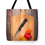 Peppers And Knife On Cutting Board Tote Bag