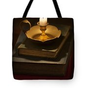 Pile Of Vintage Books By Candle Light Tote Bag