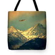 Plane Flying Over Mountains Tote Bag