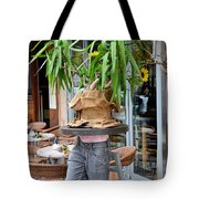 Plant And Table Top Rests On Mannequin Tote Bag