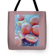 Plum Tomatoes On A Wooden Board Tote Bag by Romulo Yanes