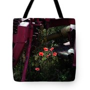 Poppies Growing Amongst Farm Machinery In A Farmyard Near Pocklington Yorkshire Wolds East Yorkshire Tote Bag