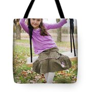 Portrait Of Young Girl On Swing Tote Bag by Vast Photography