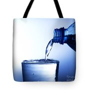 Pouring Fresh Water Into A Glass Tote Bag