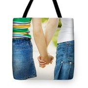 Rear View Of Girls Holding Hands Tote Bag by Design Pics RF