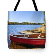 Red Canoe On Shore Tote Bag