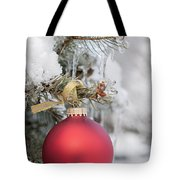 Red Christmas Ornament On Snowy Tree Tote Bag