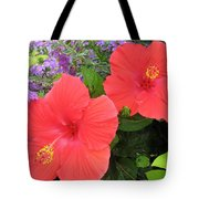 Red Hibiscus And Purple Blossoms Tote Bag