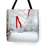 Red Ribbon In Tree Tote Bag by Amanda Elwell