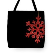 Red Snow Flake On A Black Background Tote Bag