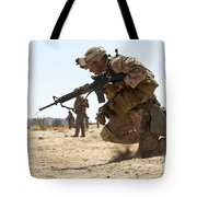 Rifleman Kneels To The Ground While Tote Bag