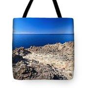 rocky coast in San Pietro island Tote Bag