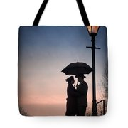 Romantic Couple Under A Street Lamp At Sunset Tote Bag