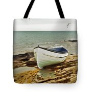 Row Boat On Rocky Shore Tote Bag