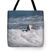 Royal Penguin Swimming In Surf Tote Bag