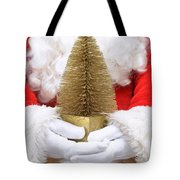 Santa Claus Holding Christmas Tree Tote Bag