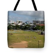 Schoolchildren Practicing On Playing Field With Singapore Skyline In Background Tote Bag