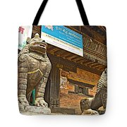 Sculptures Of Protector Figures In Front Of Sufata Buddhist College In Patan Durbar Square Tote Bag