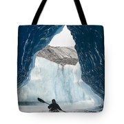 Sea Kayaker Paddles Through An Ice Cave Tote Bag