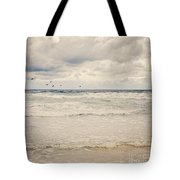 Seagulls Take Flight Over The Sea Tote Bag