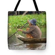 Senior Woman Paddling A Boat Tote Bag