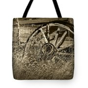 Sepia Toned Photo Of An Old Broken Wheel Of A Farm Wagon Tote Bag