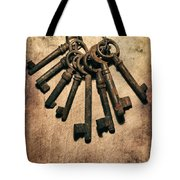 Set Of Old Rusty Keys On The Metal Surface Tote Bag