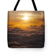 Setting Sun Above The Clouds Tote Bag