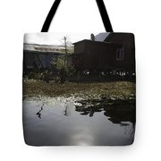 Shack And House Along With Weeds Right On Shore Of Dal Lake Tote Bag