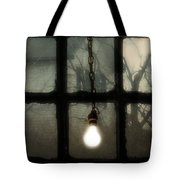 Lit Light Bulb Shines In Old Window Tote Bag