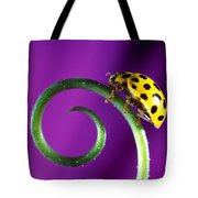 Side View Close Up Of Yellow Ladybug Tote Bag by Panoramic Images