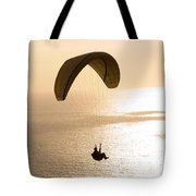 Silhouette Of A Paraglider Flying Tote Bag